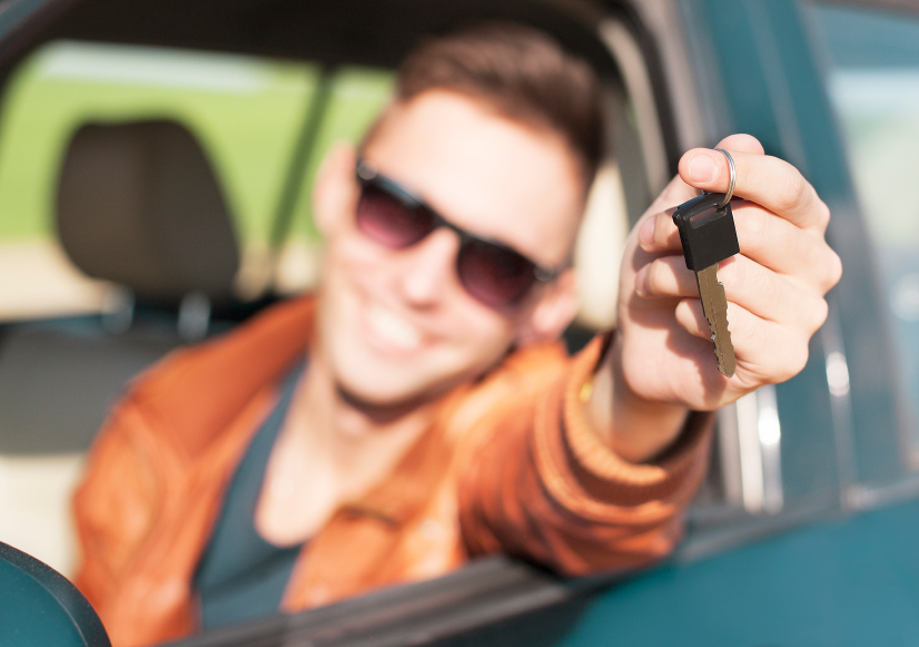Young man showing car keys - Stock Image